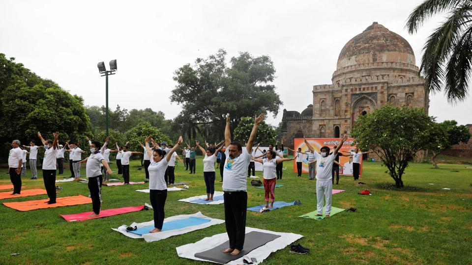 Participants, some wearing protective face masks against the coronavirus disease (COVID-19) outbreak, perform yoga during World Yoga Day in New Delhi.