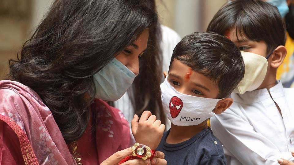 A young girl ties 'rakhi' on the wrist of her brother on the occasion of 'Raksha Bandhan',in Chennai.