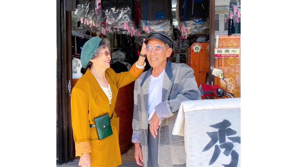Chang Wan-ji (R) and his wife Hsu Sho-er pose for photographs at their laundry store in Taichung, Taiwan in a photo released on August 1. Taiwan's trendiest couple these days are neither young celebrities nor teen influencers -- they are an octogenarian duo who run a mom-and-pop laundry service and have become an online sensation by modelling abandoned clothes. (Reef Chang / AFP)
