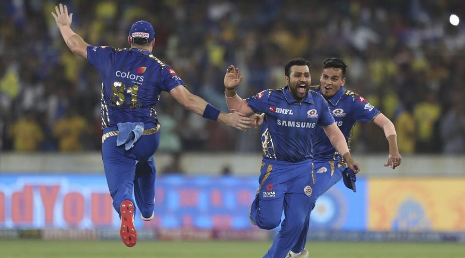 Mumbai Indians captain Rohit Sharma, second right, and teammates celebrate their win in the VIVO IPL T20 cricket final match between Mumbai Indians and Chennai Super Kings in Hyderabad.