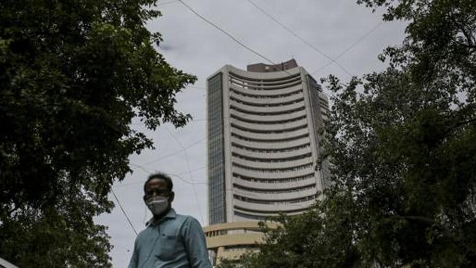 A pedestrian wearing a protective mask walks near the Bombay Stock Exchange (BSE) building in Mumbai.