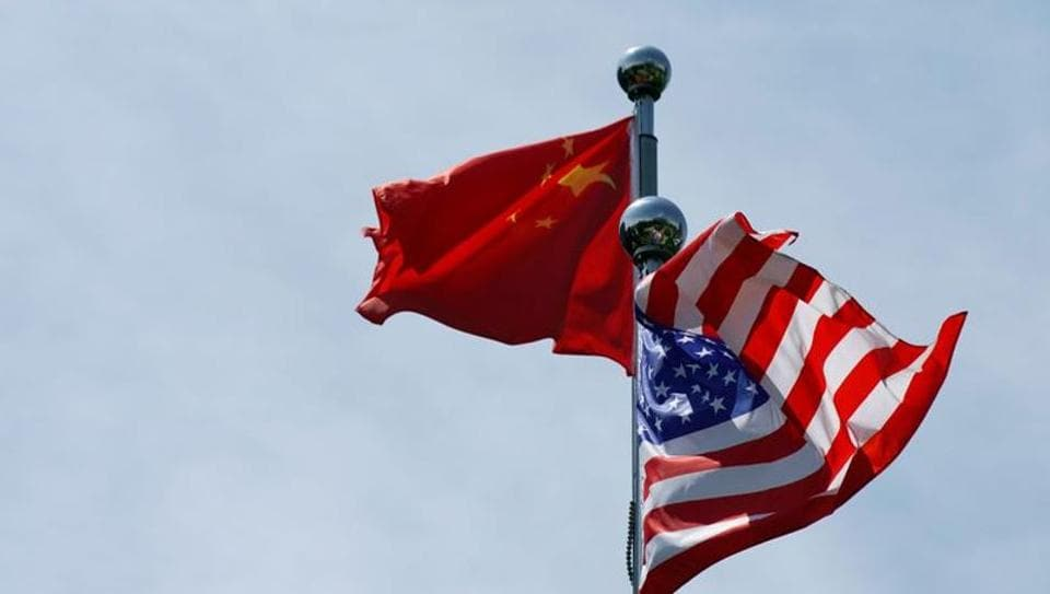Chinese and US flags flutter before a trade meeting in Shanghai, China.