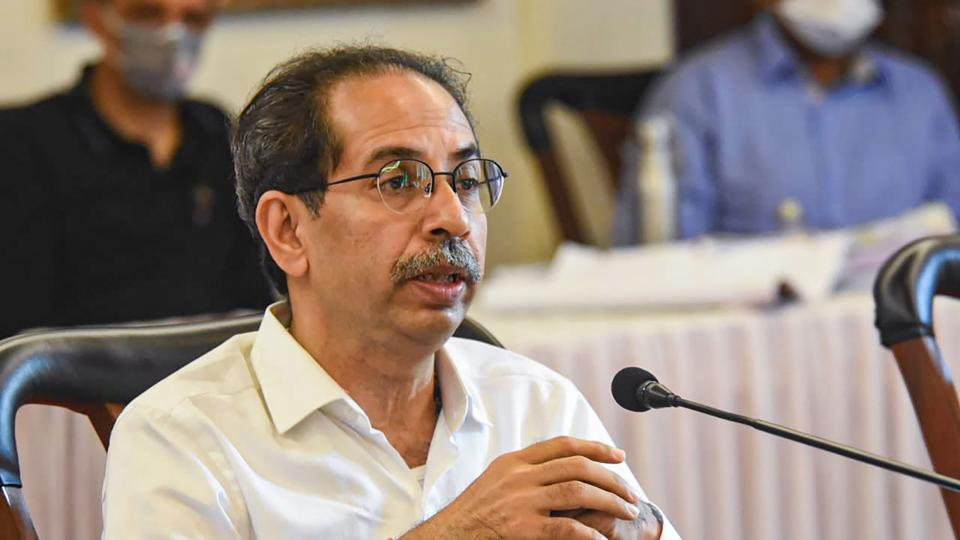 Maharashtra chief minister Uddhav Thackeray interacts with senior officials at a review meeting in Pune.