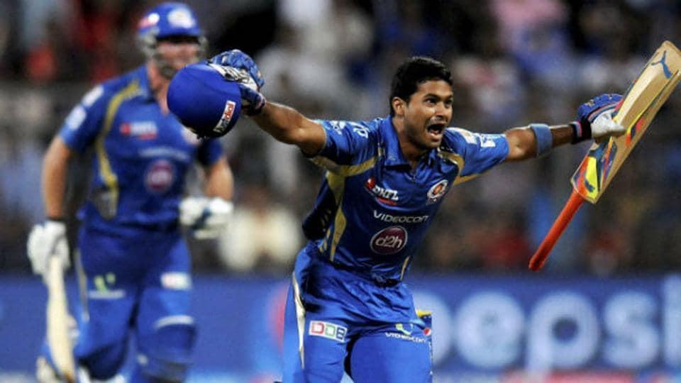 Aditya Tare celebrates after hitting the winning six.