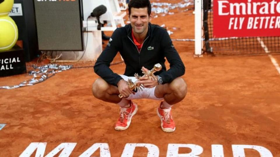 Serbia's Novak Djokovic celebrates with the trophy after winning the final against Greece's Stefanos Tsitsipas.