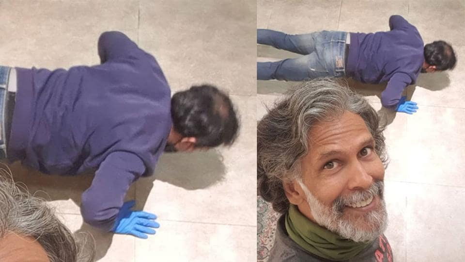 Milind Soman clicks a selfie with fan who is seen doing pushups.