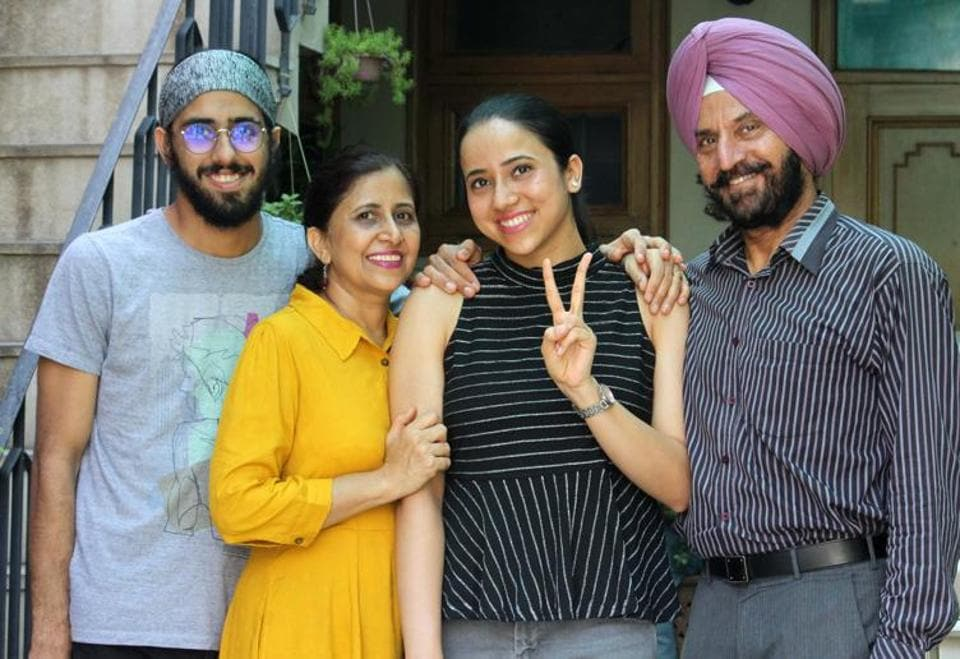 Darpan Ahluwalia, who ranked 80th in the country and second in the tricity, celebrating her success with her family in Mohali on Tuesday.