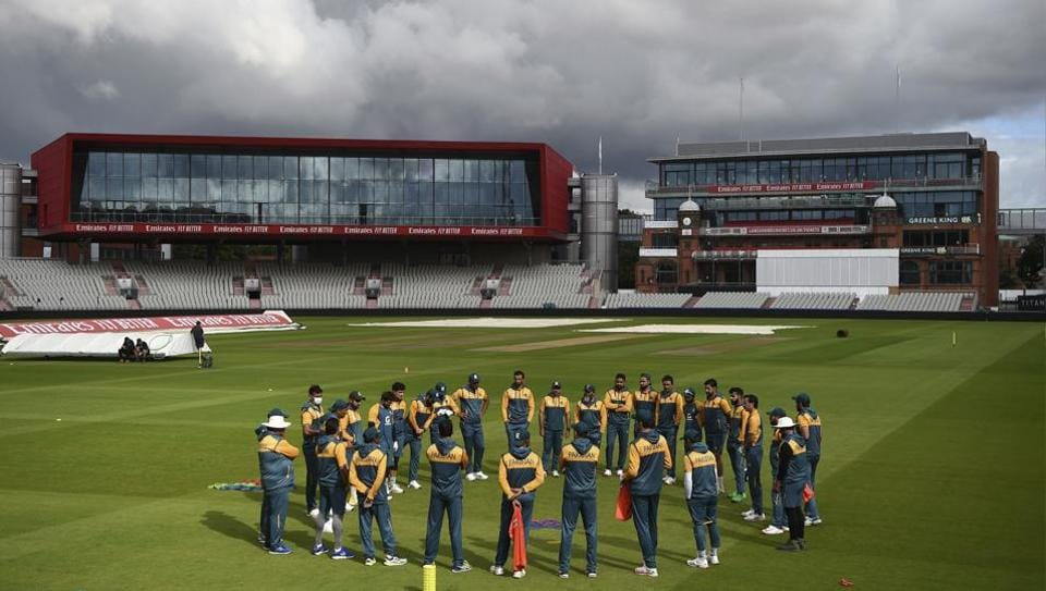 Pakistan cricket team huddle during a nets session at Old Trafford ground in Manchester, England, Monday Aug. 3, 2020.