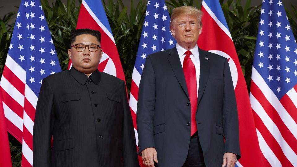 US President Donald Trump, right, meets with North Korean leader Kim Jong Un on Sentosa Island, in Singapore.