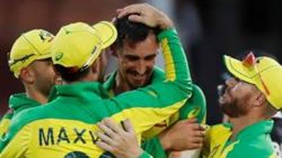 Australia's Mitchell Starc celebrates with teammates.