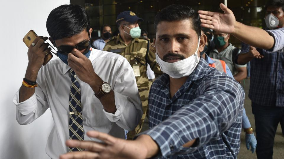 IPS officer Vinay Tiwari (in white shirt) arrives at Mumbai airport on Monday to probe actor Sushant Singh Rajput's death case.