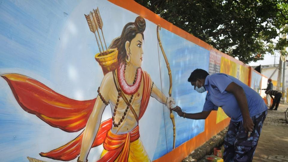 An artist making a painting of Lord Ram on the wall of Karsevak Puram for Bhoomi Poojan of Ram Mandir in Ayodhya