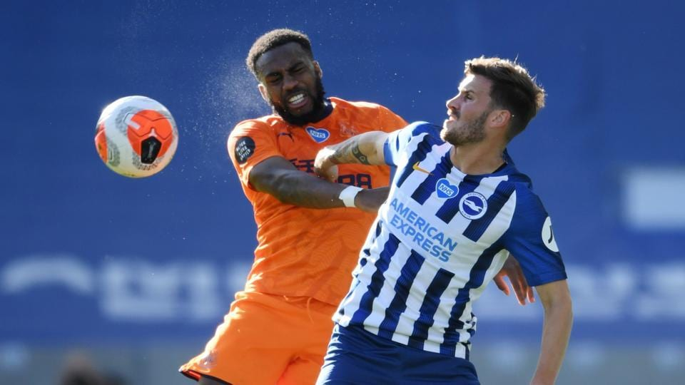 Brighton & Hove Albion's Pascal Gross in action with Newcastle United's Danny Rose.