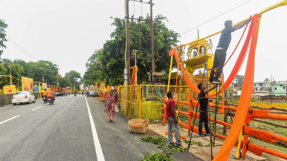 Workers decorate an area ahead of the groundbreaking ceremony of Ram temple, in Ayodhya on Tuesday.