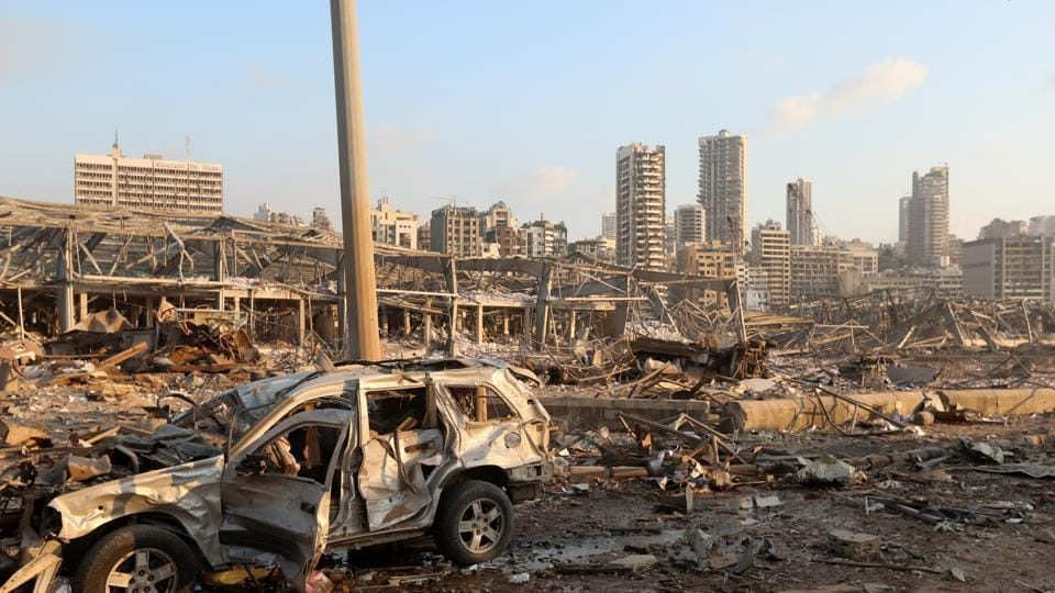 A damaged vehicle is seen at the site of an explosion in Beirut, Lebanon.