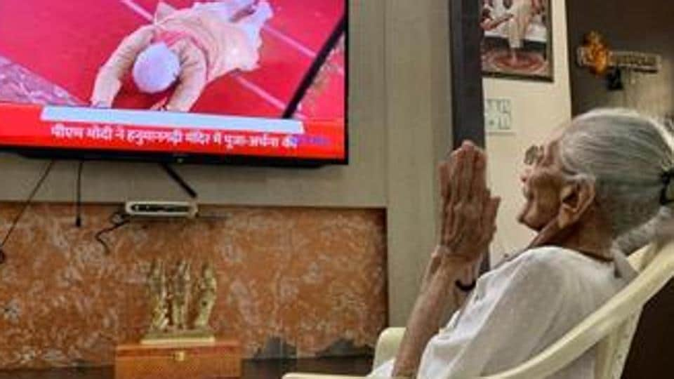 PM Modi's mother Heeraben watching Ram temple event in Ayodhya on her TV. (ANIphoto)
