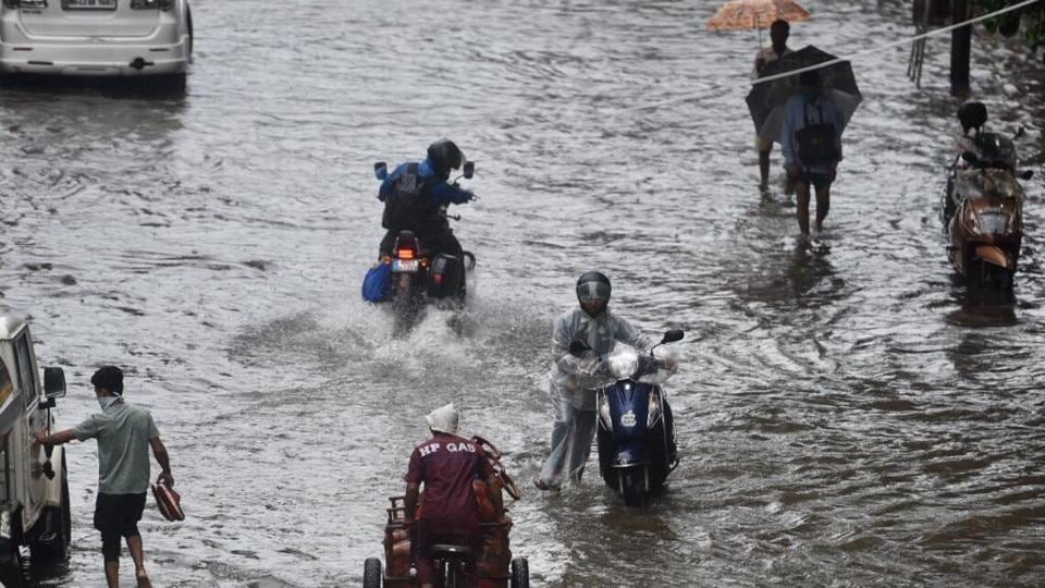 People wading through a waterlogged street in Chembur on Wednesday.