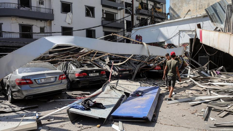 Debris from a residential apartment block covers automobiles parked outside in Beirut, Lebanon, on Wednesday, Aug. 5, 2020.