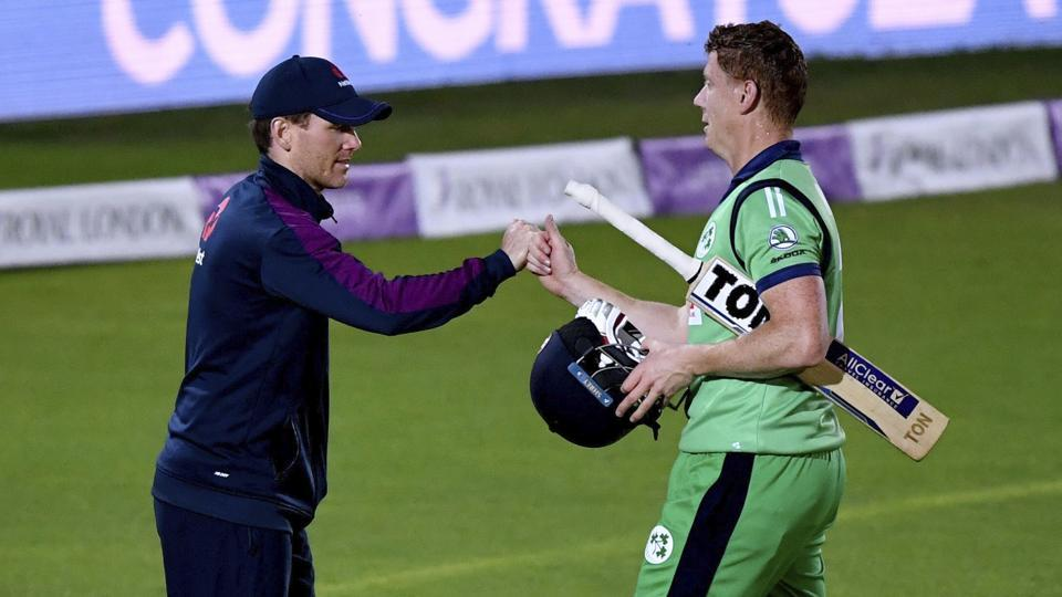 England captain Eoin Morgan, left, congratulates Ireland's Kevin O'Brien after Ireland won the third One Day International, ODI, cricket match between England and Ireland, at the Ageas Bowl in Southampton, England, Tuesday Aug. 4, 2020.