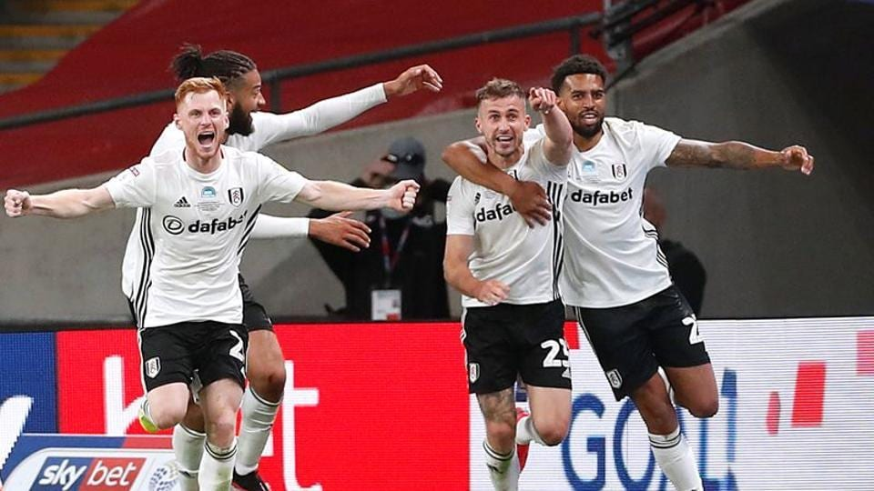 Fulham's Joe Bryan celebrates scoring their second goal with teammates.