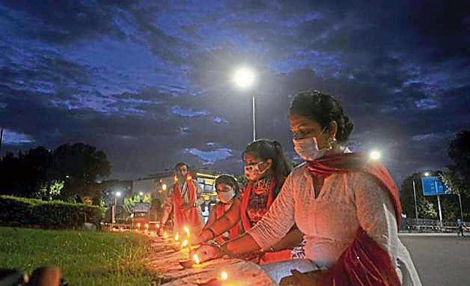 Residents lighting lamps at Sector 17/18 roundabout to celebrate bhoomi poojan of Ayodhya's Ram Temple in Chandigarh on Wednesday.