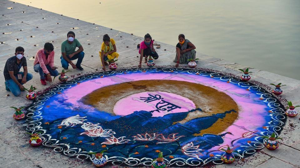People make 'rangoli' at Naya Ghat on the eve of the groundbreaking ceremony of the Ram Mandir, in Ayodhya.