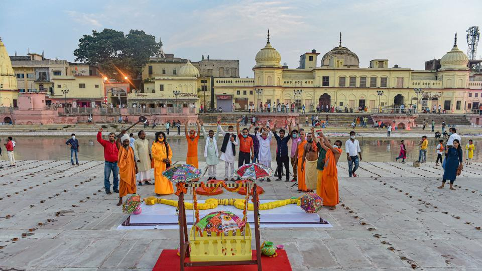 Large wooden slippers, bow and arrow, and palanquin put on display at Naya Ghat, on the eve of the groundbreaking ceremony of the Ram Mandir, in Ayodhya, on Tuesday.