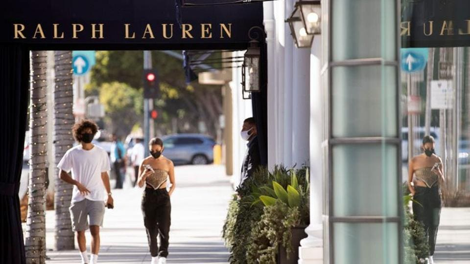 A security guard stands outside the Ralph Lauren store during the outbreak of the coronavirus disease (COVID-19), in Beverly Hills, California, U.S., July 30, 2020.