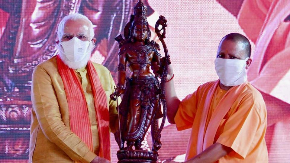 Prime Minister Narendra Modi being presented with a statue by Uttar Pradesh Chief Minister Yogi Adityanath during the foundation stone laying ceremony of Ram Temple in Ayodhya.