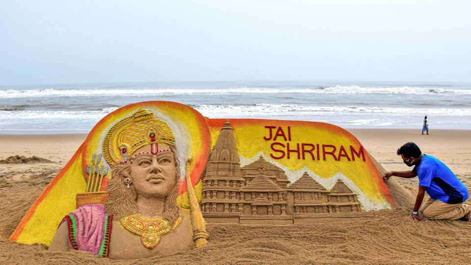 Artist Sudarsan Pattnaik makes a replica of Ram temple out of sand, on the eve of its ground-breaking ceremony in Ayodhya, on Puri beach,