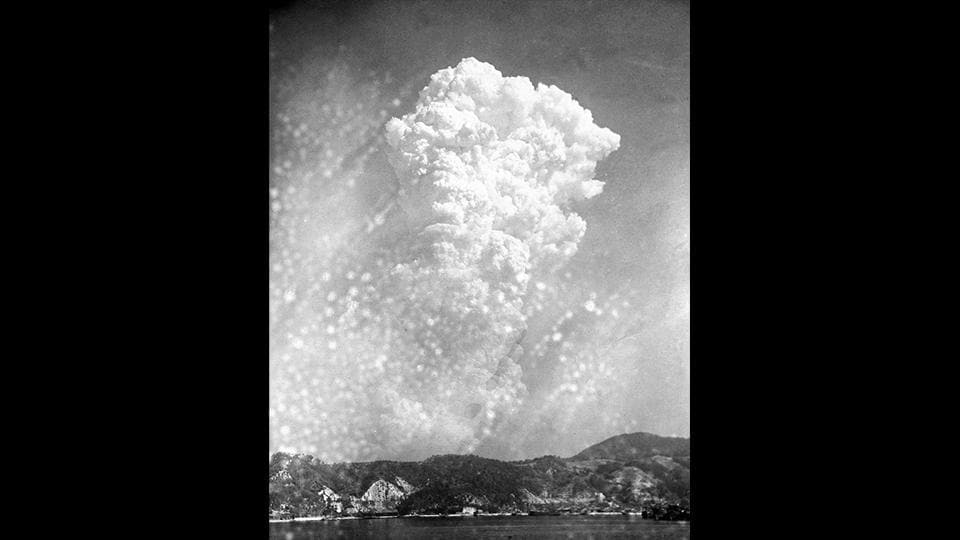 "Smoke rises 20,000 feet above Hiroshima after the first atomic bomb was dropped at 8:15 am on August 6, 1945 by the US B-29 warplane Enola Gay.  Nicknamed ""Little Boy,"" the explosion obliterated the city of around 350,000, killing tens of thousands instantly. Thousands more died later from injuries and radiation-related illnesses. A total of 140,000 people were killed due to the explosion. (AP File)"