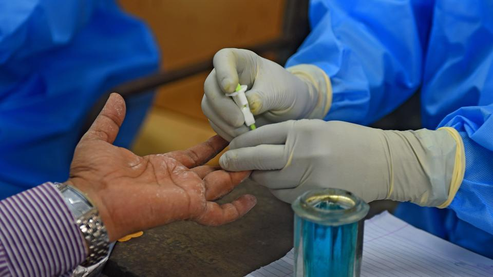 A health  worker collects plasma sample from patients who recovered from Covid-19.