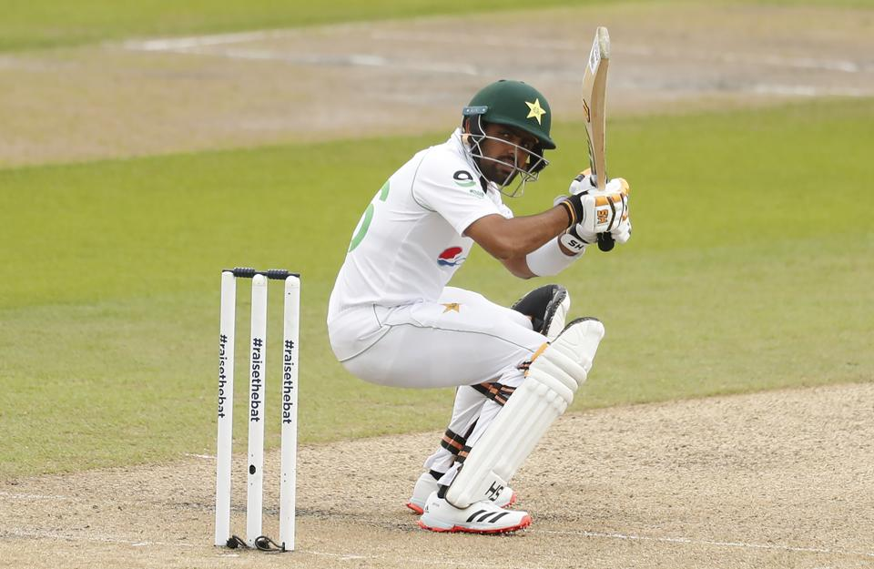 Pakistan's Babar Azam evades a rising delivery during the first day of the first cricket Test match between England and Pakistan at Old Trafford in Manchester, England, Wednesday, Aug. 5, 2020. (Lee Smith/Pool via AP)