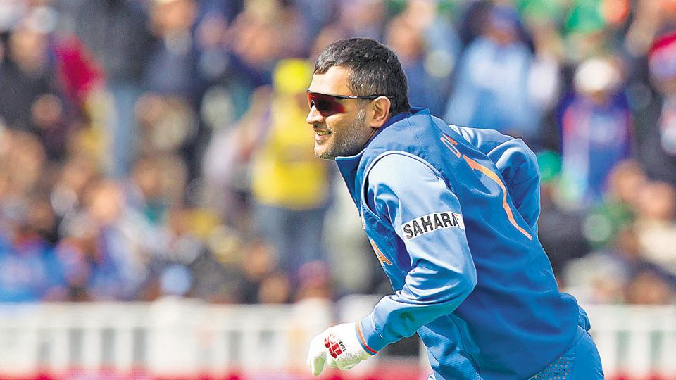 India's MS Dhoni reacts after catching Pakistan's Asad Shafiq for 41 off the bowling of Ishant Sharma during their ICC Champions Trophy cricket match at Edgbaston cricket ground, Birmingham, England, Saturday June 15, 2013.