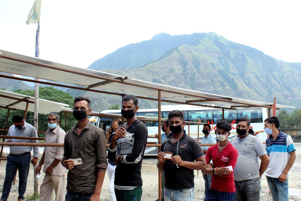Kullu police checking passengers of Volvo bus at  Bajuara barrier in wake of Covid-19 outbreak in the region.