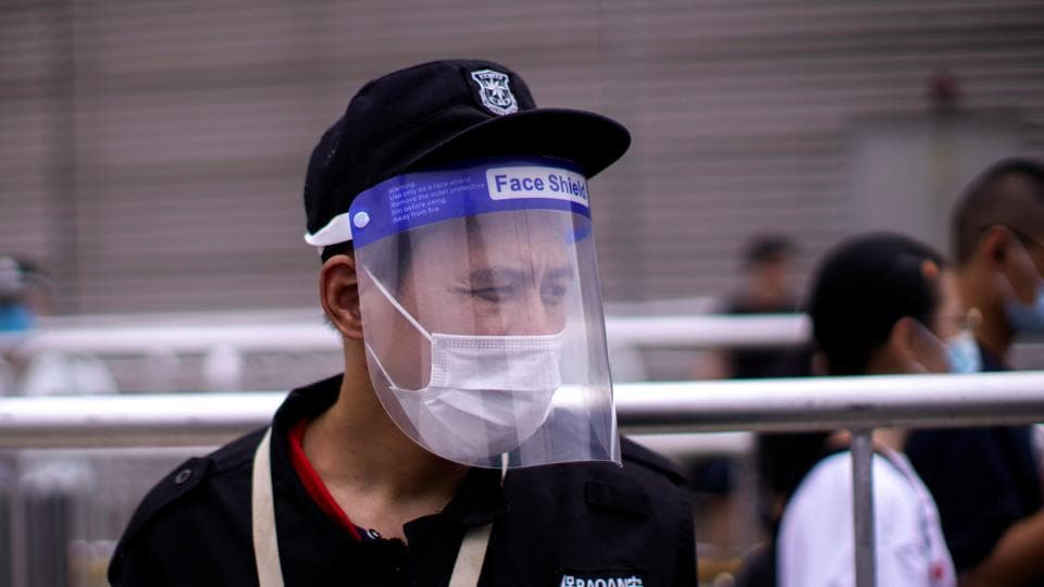 A man wearing a protective face mask and a face shield in Shanghai.