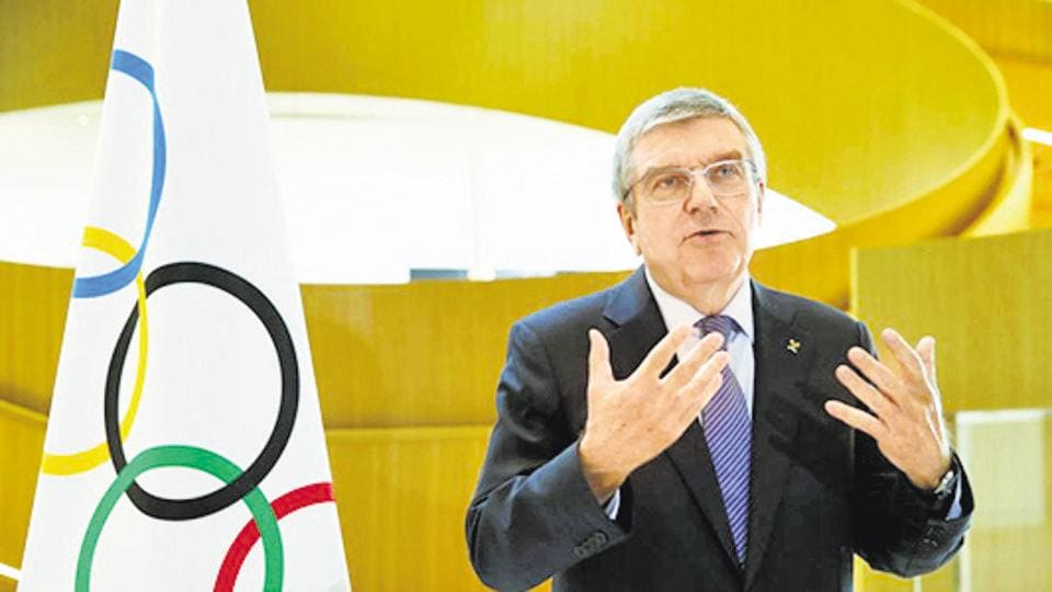FILE PHOTO: Thomas Bach, President of the International Olympic Committee (IOC) attends an interview after the decision to postpone the Tokyo 2020 because of the coronavirus disease (COVID-19) outbreak, in Lausanne, Switzerland, March 25, 2020. REUTERS/Denis Balibouse/File Photo