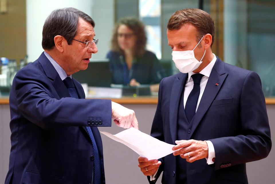 Cypriot President Nicos Anastasiades and France's President Emmanuel Macron speak during the first face-to-face EU summit since the coronavirus disease (Covid-19) outbreak, in Brussels, Belgium July 18, 2020.