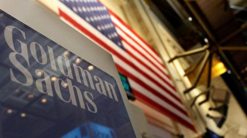 A Goldman Sachs sign is seen above their booth on the floor of the New York Stock Exchange.