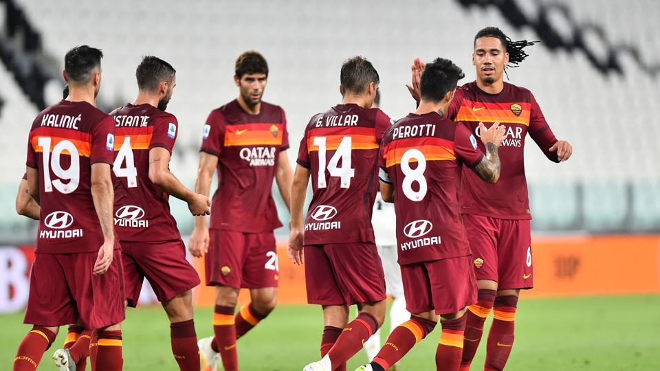 AS Roma's Diego Perotti celebrates scoring their second goal with teammates.