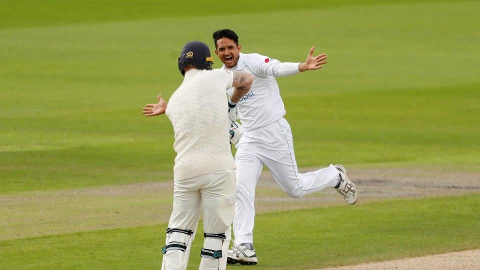 Cricket - First Test - England v Pakistan - Emirates Old Trafford, Manchester, Britain - August 6, 2020 Pakistan's Mohammad Abbas celebrates taking the wicket of England's Ben Stokes, as play resumes behind closed doors following the outbreak of the coronavirus disease (COVID-19) REUTERS/Lee Smith/Pool