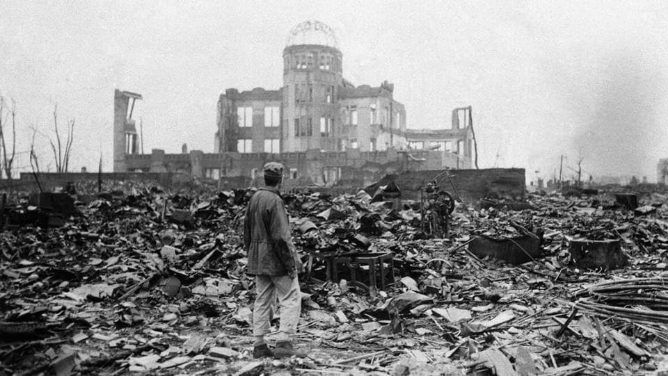 An allied correspondent stands in a sea of rubble before the shell of a building that once was a movie theatre in Hiroshima on September 8, 1945, a month after the first atomic bomb ever used in warfare was dropped by the US to hasten Japan's surrender. Many people exposed to radiation developed symptoms such as vomiting and hair loss. Most of those with severe radiation symptoms died within three to six weeks. (Stanley Troutman / AP File)