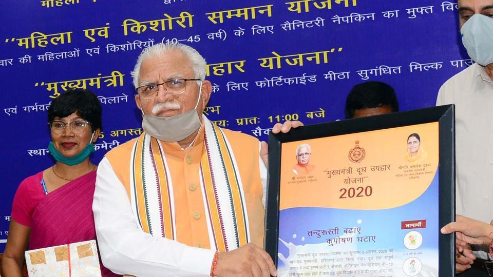 Haryana Chief Minister Manohar Lal launching a poster of the 'Mahila Evam Kishori Samman Yojana' of the Women and Child Development Department in Chandigarh.
