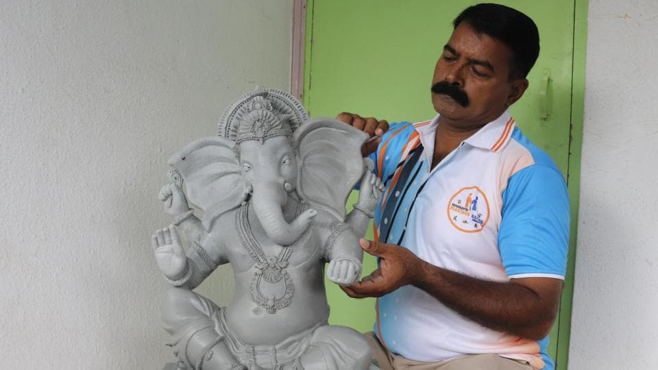 Balu Ganpat Chavan, 46, a head constable in Central police station in Ulhasnagar, works on the idol.