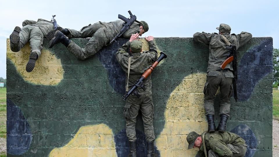 Russian marines take part in a contest at Khmelevka in Kaliningrad Region, Russia. Western nations said after a closed briefing to the UNSC on Wednesday that Russia's continuing military presence in Abkhazia, South Ossetia violates Georgia's territorial integrity.