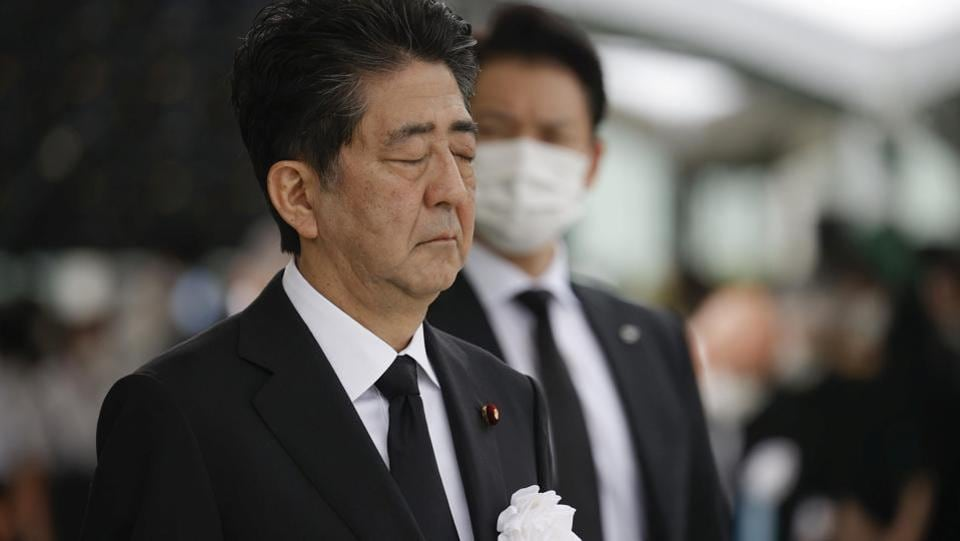 "Japan's Prime Minister Shinzo Abe offers a silent prayer for the victims of the 1945 atomic bombing, at Peace Memorial Park in Hiroshima on August 6. Hiroshima Mayor Matsui urged Japan to ratify a 2017 United Nations pact banning nuclear arms, but Abe avoided any direct reference, saying Japan would ""work as a bridge between nations"" to abolish nuclear weapons, Reuters reported. (Kyodo via REUTERS)"