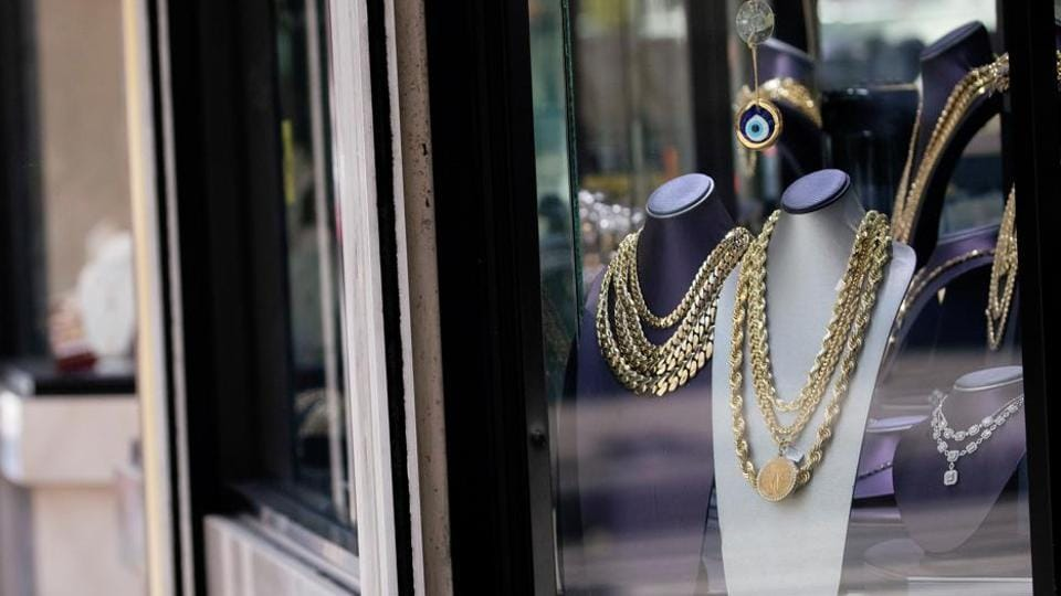 Gold items are seen on a display window of a gold and jewellery store in Los Angeles.