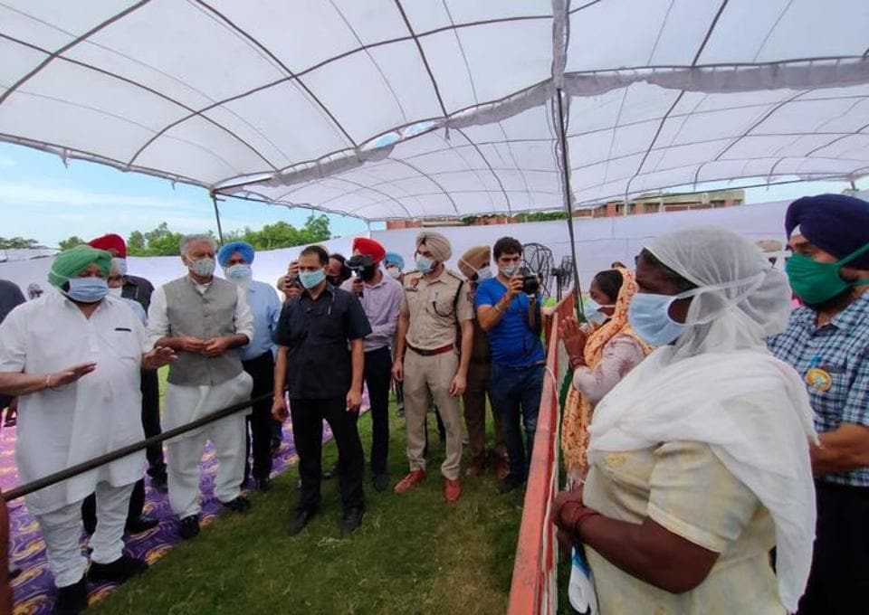 Punjab chief minister Capt Amarinder Singh interacting with family members of the hooch tragedy victims in Tarn Taran on Friday. This was Amarinder's first field visit since the Covid-19 outbreak.