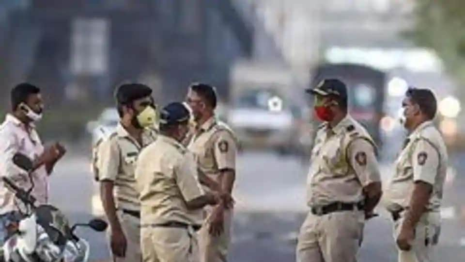 The transfer order was issued after angry traders downed shutters in Kharogone town and took out a protest march on Thursday, demanding action against the alleged errant officials.