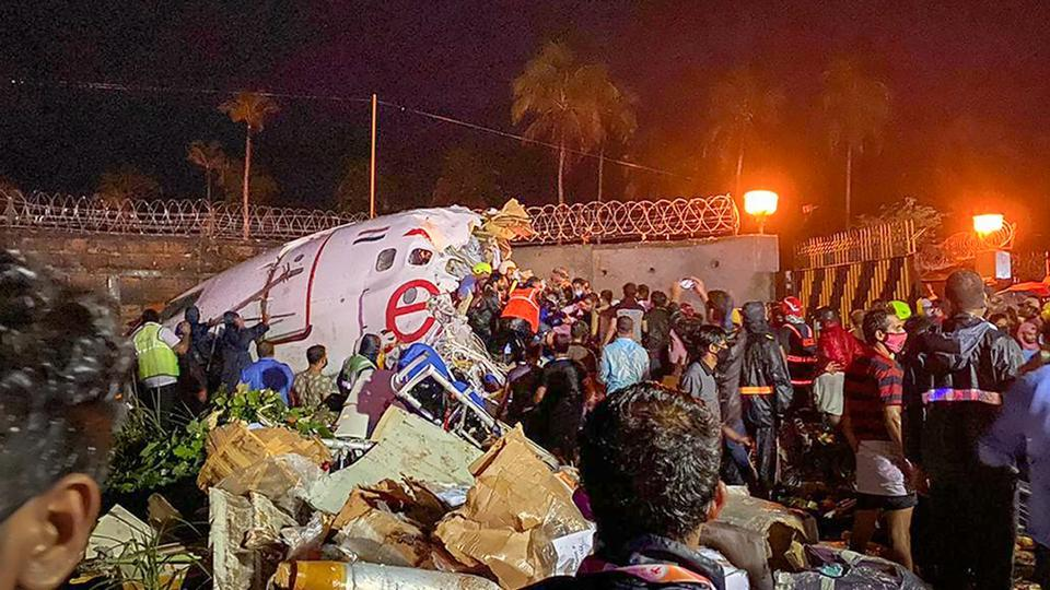 Rescue operations underway after an Air India Express flight with 190 passengers on board enroute from Dubai skidded off the runway while landing, at Karipur airport in Kozhikode on Friday.